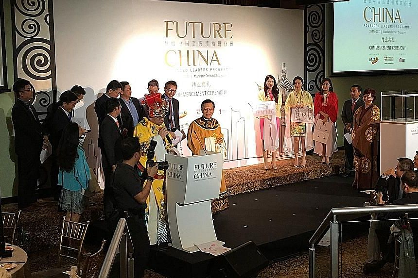 Participants of the Future China Advanced Leaders Programme putting on a skit yesterday at a ceremony marking the end of their three-week course. Mr Chee Hong Tat, who spoke at the event, said that it is in Singapore's interest and the region's inter