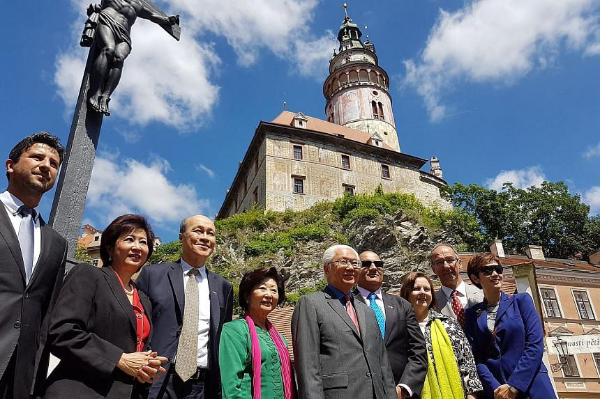 Above: Singapore President Tony Tan Keng Yam and his wife, Mary, with members of the Singapore business delegation on a river cruise in Prague, with the Charles Bridge behind them. Right: Dr Tony Tan and Mrs Mary Tan with (from left) Mr Josef Knot, f