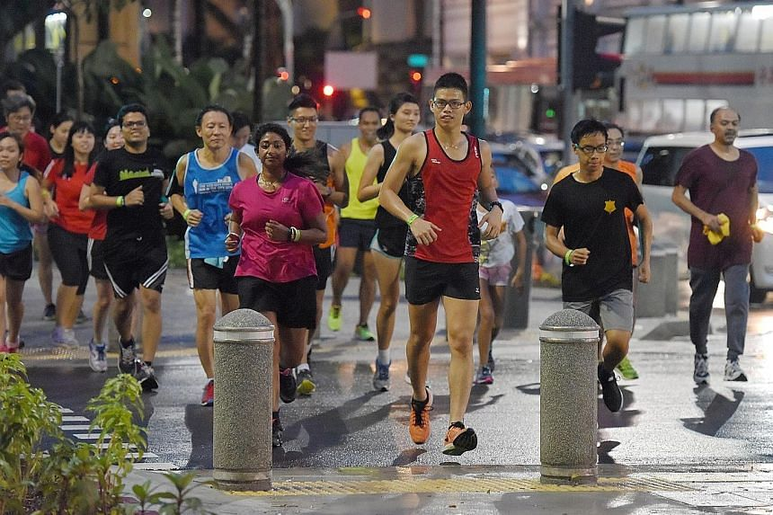 Participants at yesterday's Sunset Run crossing the road to the end point. The ST Run build-up event was followed by dinner at SMU's alumni-run B3 Burger Beer Bistro.