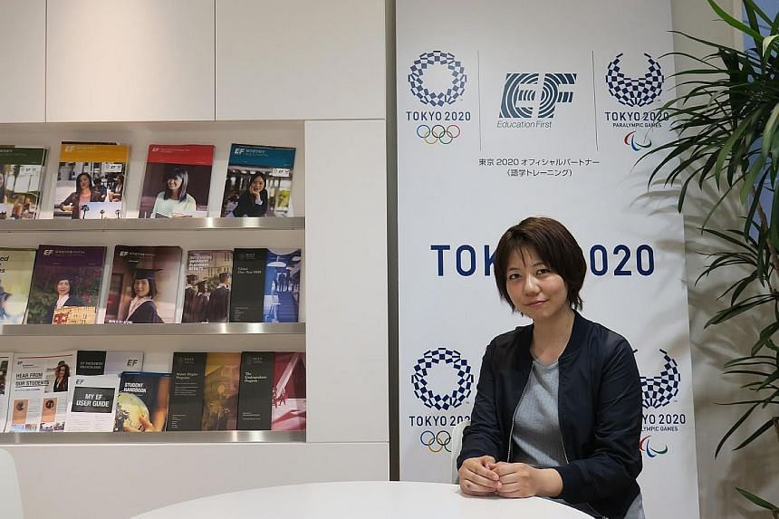 Besides having bilingual street signs, Tokyo is also getting the Japanese to brush up on English. Ms Mariko Tomi (left) was in Singapore for two months under an English course run by official Games partner EF.