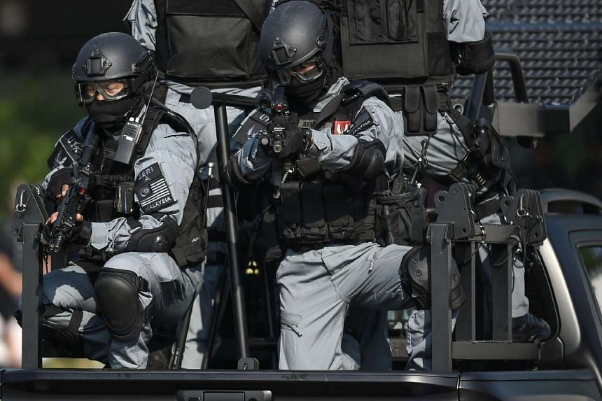 Members of the Royal Malaysian Police elite high-profile counter-terrorism tactical unit.