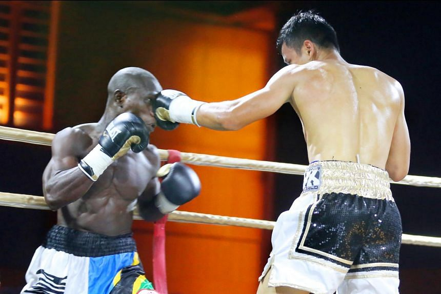 Singapore's Muhammad Ridhwan lands a punch on Tanzania's Fadhili Majiha, during their bout on May 27, 2017.