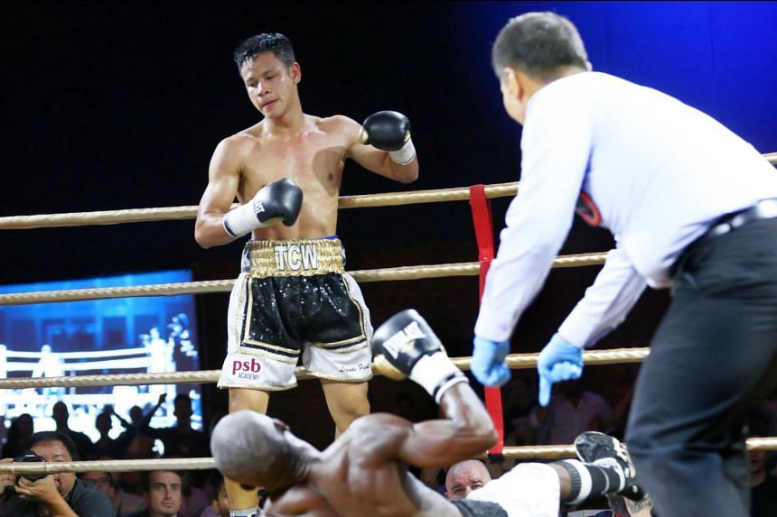 Singapore's Muhammad Ridhwan backs off after knocking down Tanzania's Fadhili Majiha during their bout on May 27, 2017.