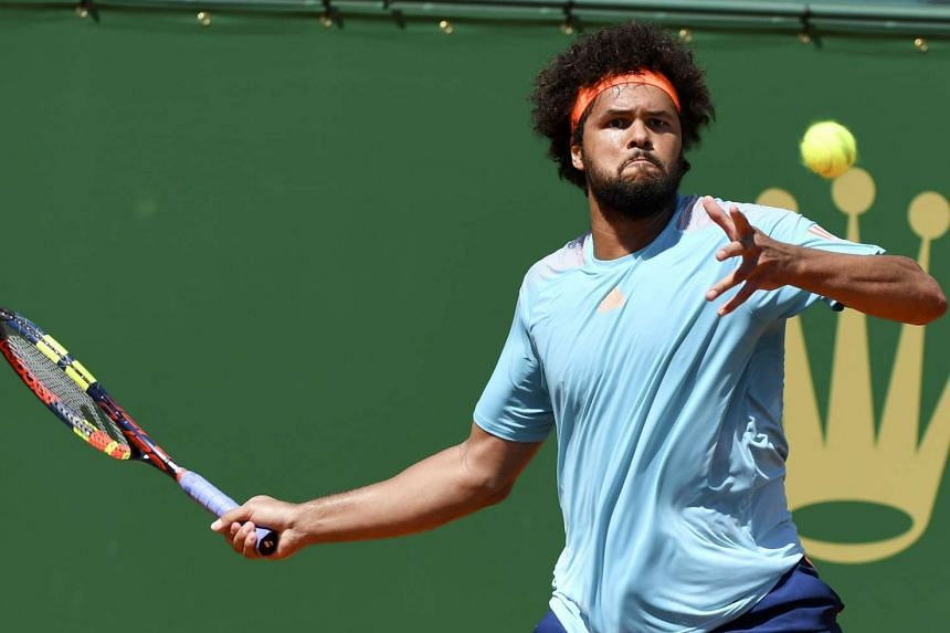 Tsonga (above, in a file photo) beat Czech Tomas Berdych 7-6(2) 7-5 in the Lyon Open.