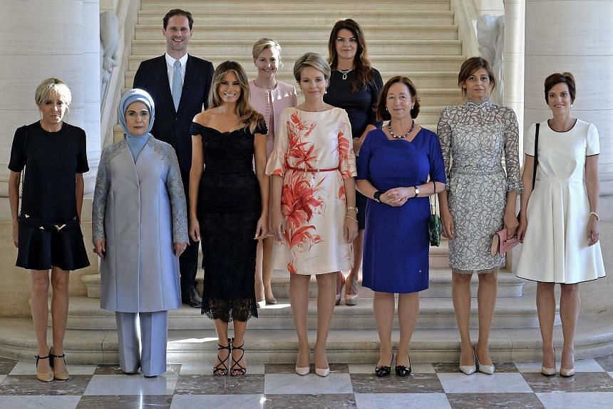 Mr Gauthier Destenay, the husband of Lxembourg PM Xavier Bettel, with other spouses of world leaders prior to a dinner on the sidelines of the Nato summit in Brussels on May 25, 2017.