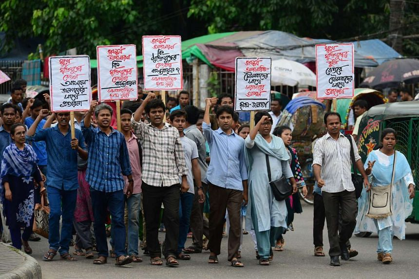 Bangladeshi left-wing students marching during a protest in Dhaka against the removal of a controversial statue in front of the Supreme Court, on May 26, 2017.