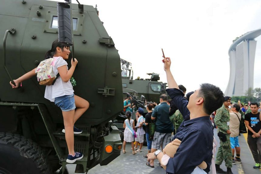 Elisa Chan, nine, (left) and Kelvin Chan, 36, at the Army Open House 27 May 2017.