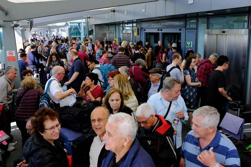 Travellers stranded at Heathrow Terminal 5 in London on May 27 after all British Airways flights from Gatwick and Heathrow airports were cancelled.