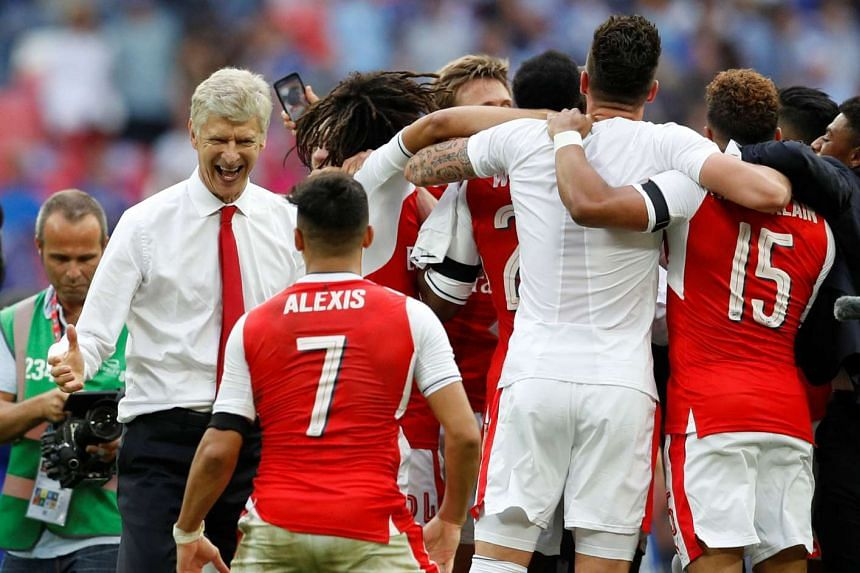 Arsenal manager Arsene Wenger and Alexis Sanchez celebrate after winning the FA Cup final.