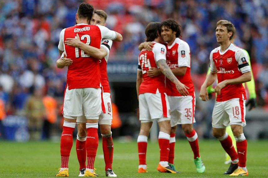 Aaron Ramsey and Olivier Giroud celebrate after winning the FA Cup final.