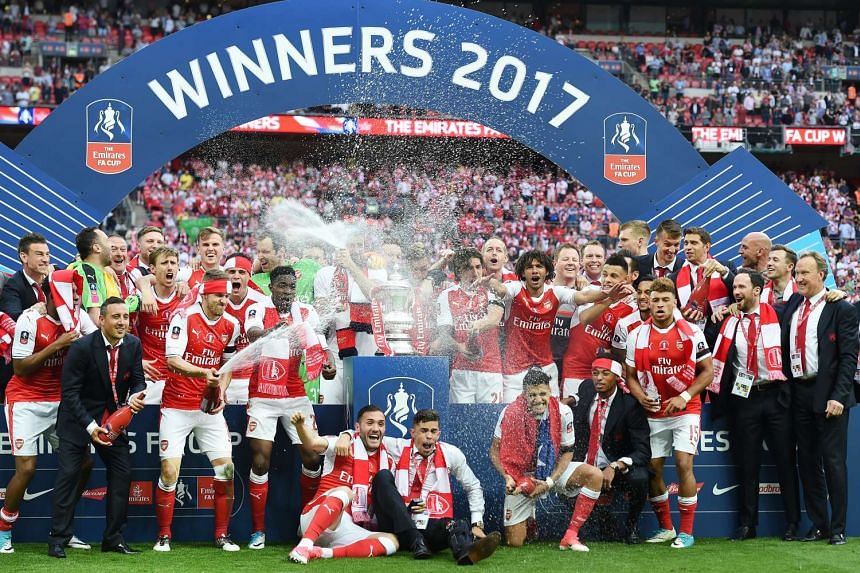 Arsenal celebrate winning the FA Cup.