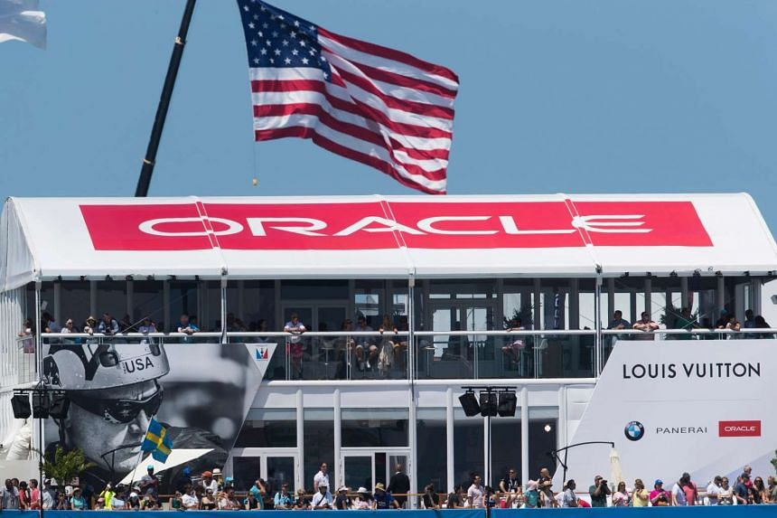The American flag flying above a sign for Oracle Team USA as the 35th America's Cup began on May 27.