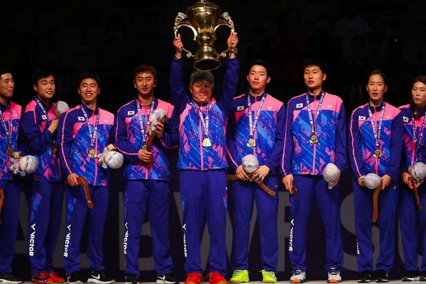 The South Korean team celebrating their victory at the Sudirman Cup in Gold Coast, Australia on May 28.