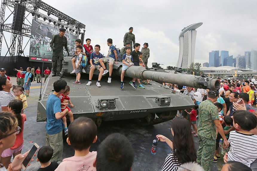Close to 33,000 visitors made their way to the F1 Pit Building yesterday to get up close with the army's latest vehicles and weaponry at the Army Open House 2017. Due to the overwhelming response, the two-day Open House, which was scheduled to end to