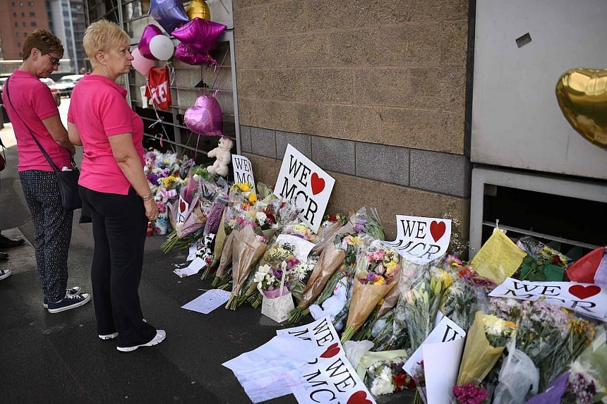 Messages of support and floral tributes to the victims of the attack outside the Manchester Arena Complex. The city's residents showed resilience and community spirit as they comforted one another.