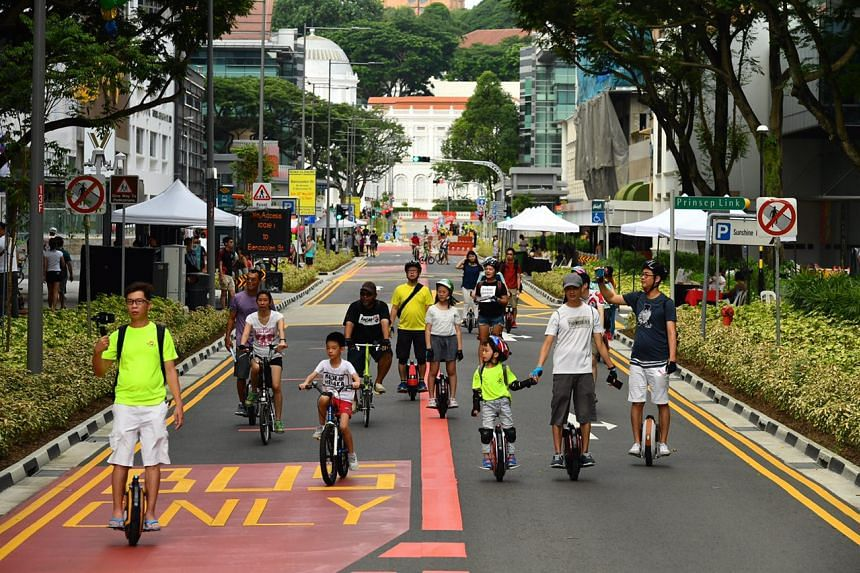 Cyclists and personal mobility device (PMD) users on Bencoolen Street.