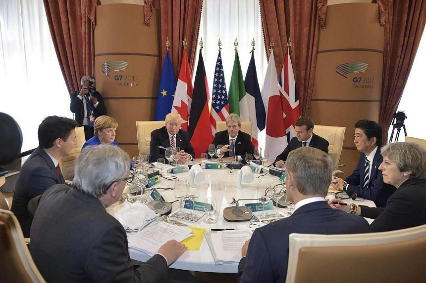 World leaders attend a meeting of the Group of Seven nations leaders at the G7 summit in Taormina, Italy.