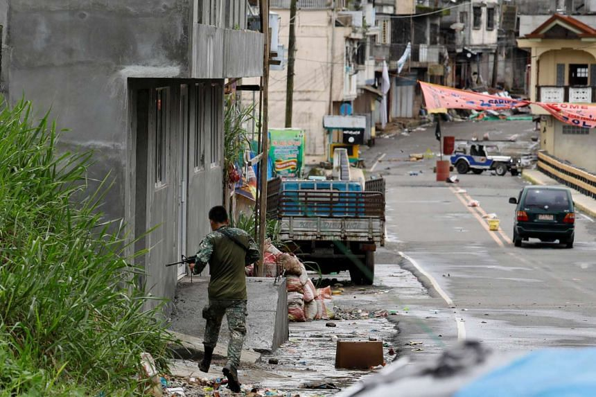 A government soldier runs in the the Maute group stronghold in Marawi City in southern Philippines on May 29, 2017.