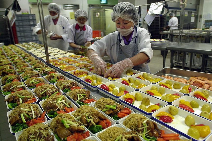 Staff preparing inflight meals.