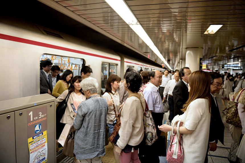 A file photo of commuters boarding a train in Japan.