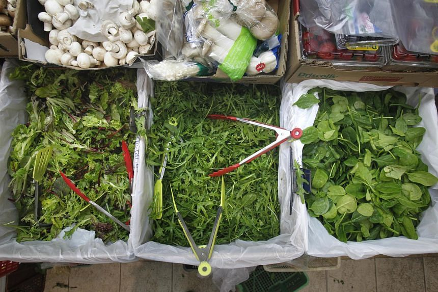 Salad leaves can be found on sale at Tekka Centre's wet market. The prices of vegetables from Malaysia have increased by as much as 20 per cent, reported Shin Min Daily News. PHOTO: ST FILE