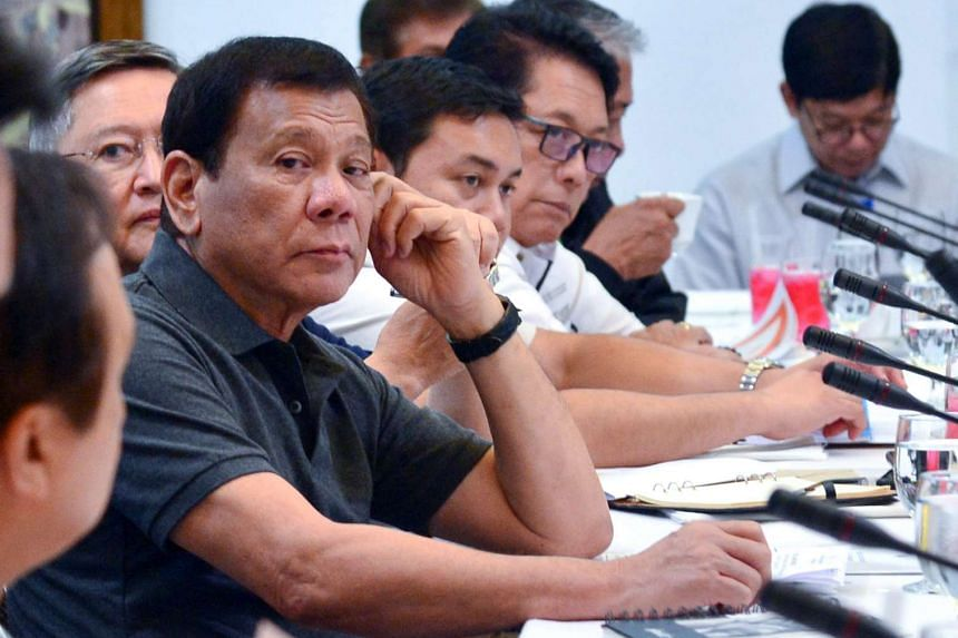 Philippine President Rodrigo Duterte presides over a special cabinet meeting at the Presidential Guest House in Panacan, Davao City, southern Philippines on May 25, 2017.