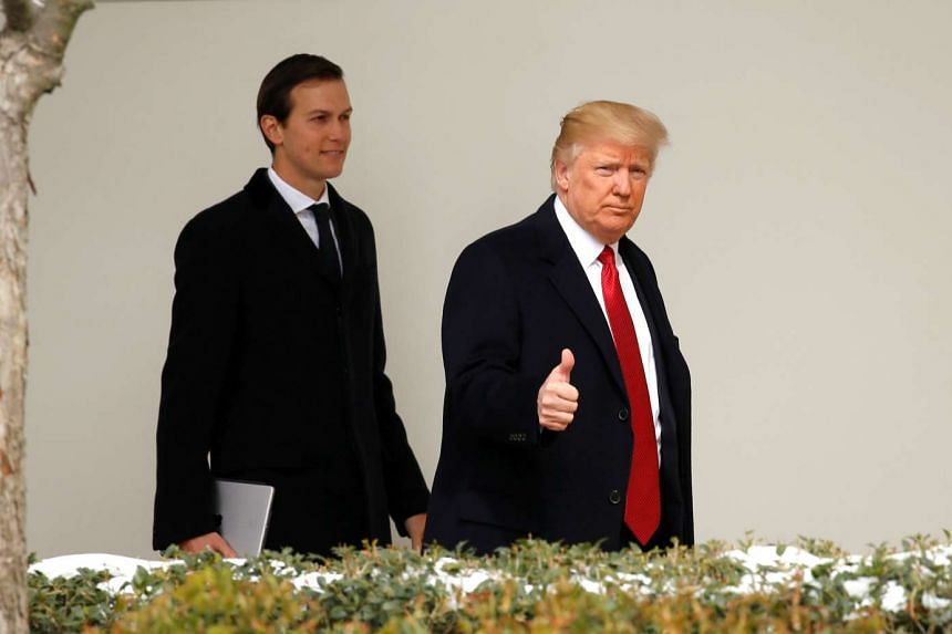 US President Donald Trump gives a thumbs-up as he and White House Senior Advisor Jared Kushner depart the White House in Washington, US on March 15, 2017.
