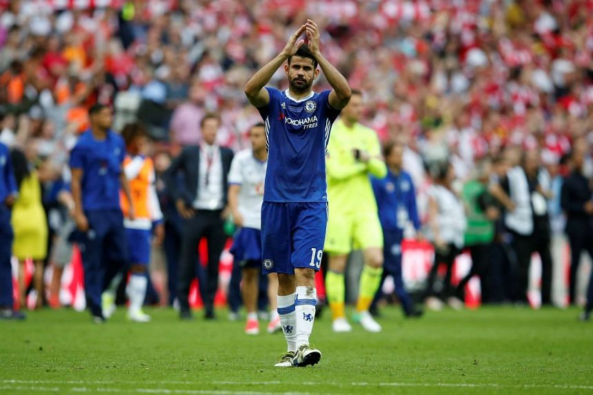 Chelsea's Diego Costa applauds the fans at the end of the FA Cup Final in Wembley Stadium on May 27, 2017.