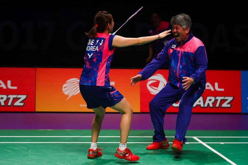 South Korean player Chae Yoo Jung (left) celebrates with head coach Kang Kyung Jin after their victory over China at the Sudirman Cup on Sunday (May 28).