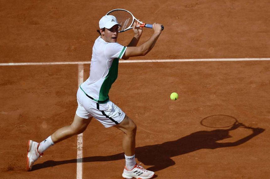 Austria's Dominic Thiem returns the ball to Australia's Bernard Tomic during their tennis match at the Roland Garros 2017 French Open on May 28, 2017 in Paris.