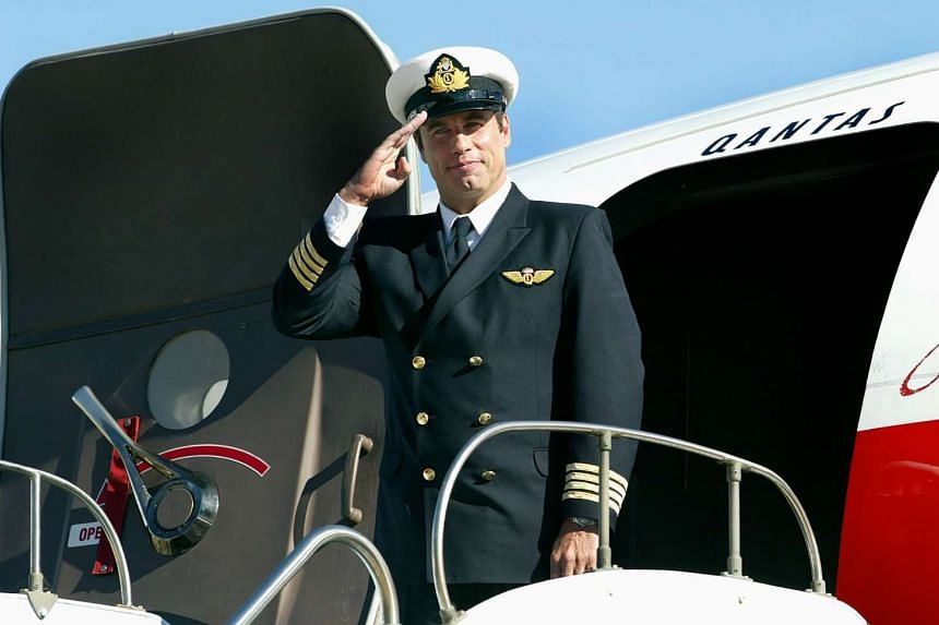 A file photo taken in 2002 shows actor John Travolta standing in front of his Boeing 707 at Sydney Airport.