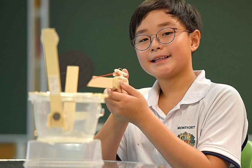 Shane Pan built a magnetic rubber-band gun in about four hours using mostly household objects, such as plastic tubs, clothes pegs and fridge magnets. Primary 1 Montfort Junior pupils enjoying their time in the school's Lego Room. It is part of the sc