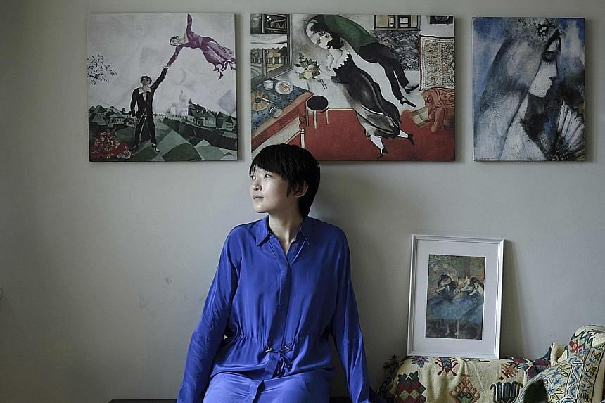 Ms Charlie Liu in her apartment in Beijing. She rents it out on Airbnb to help cover the repayments on her 1.4 million yuan mortgage.