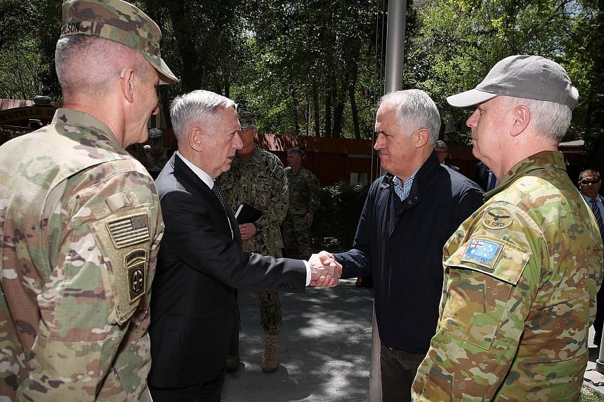 US Secretary of Defence Jim Mattis (left) greeting Australian Prime Minister Malcolm Turnbull last month at the Resolute Support headquarters in Kabul, Afghanistan. Mr Turnbull was visiting Australian troops stationed there. With the two were US Gene
