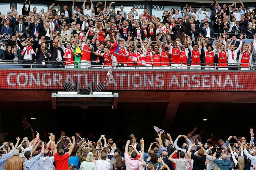 Arsenal lifting the trophy for the 13th time after an eventful game at Wembley packed with controversy.