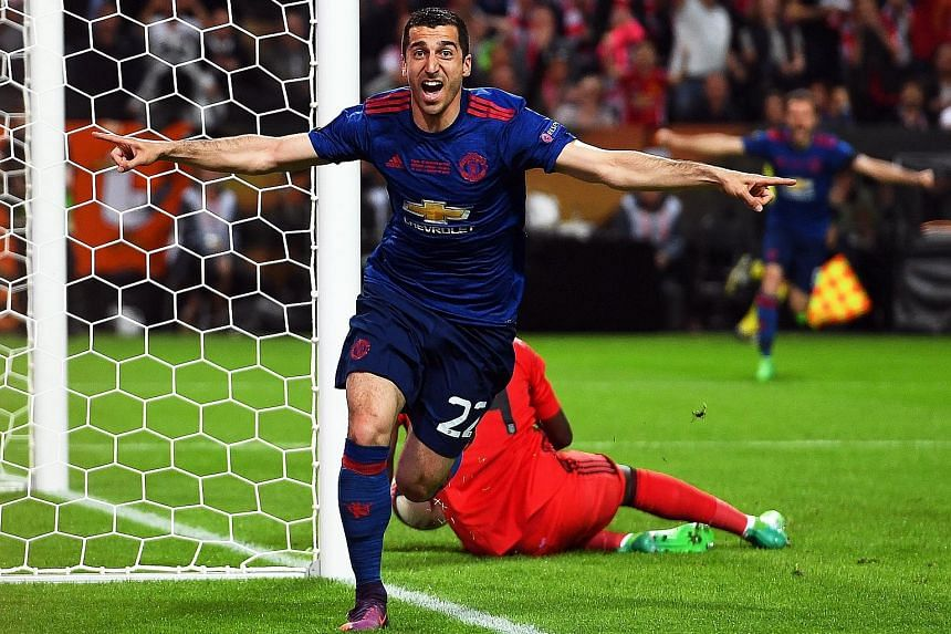 Henrikh Mkhitaryan celebrates scoring the second goal in the Europa League final. The Armenian is the first from his country to win a major European trophy, and hopes more will follow in his path.