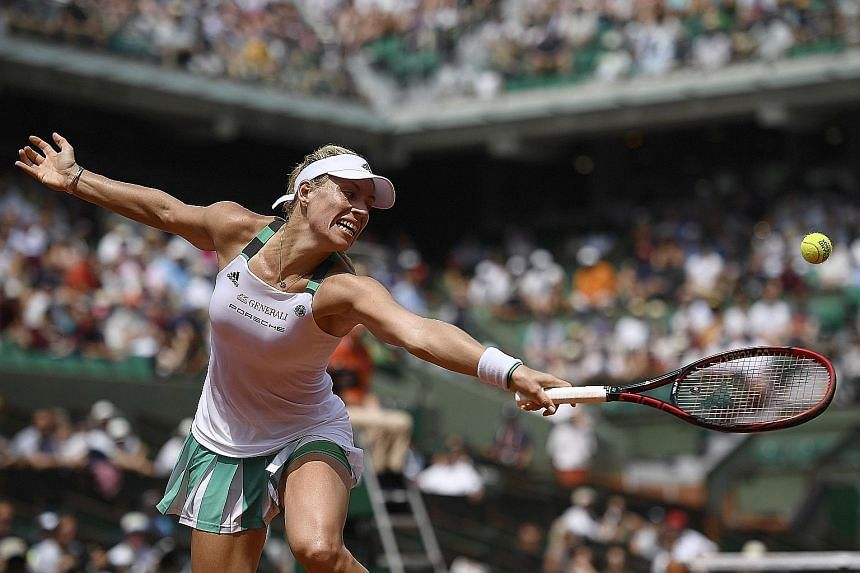 German world No. 1 Angelique Kerber struggling to return the ball to Russia's Ekaterina Makarova. The loss is her second successive one in the opening round in Paris and she could lose her top ranking to Karolina Pliskova or Simona Halep.