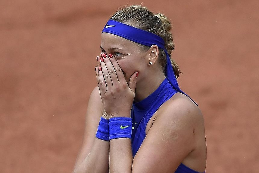 An emotional Petra Kvitova after becoming the first player to reach the second round. Her left hand was badly injured in an attack late last year.