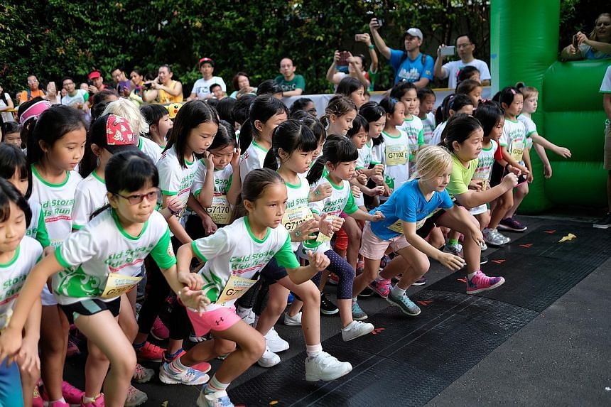 The Cold Storage Kids Run pulled out all the stops this year, celebrating its 10th anniversary at Sentosa for the first time. One of nine events was the 800m boogey banana sprint race for girls 7-8 years old. This year's event drew a crowd of 9,000.