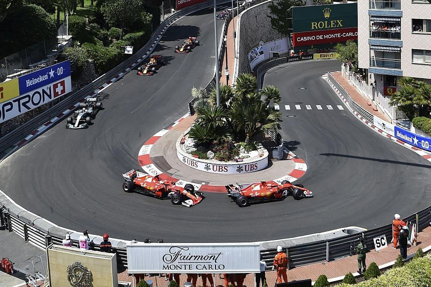 Kimi Raikkonen just ahead of Ferrari team-mate Vettel going round the Grand Hotel Hairpin. Though he tried to put up a united front, he would not have been happy with being pitted first.