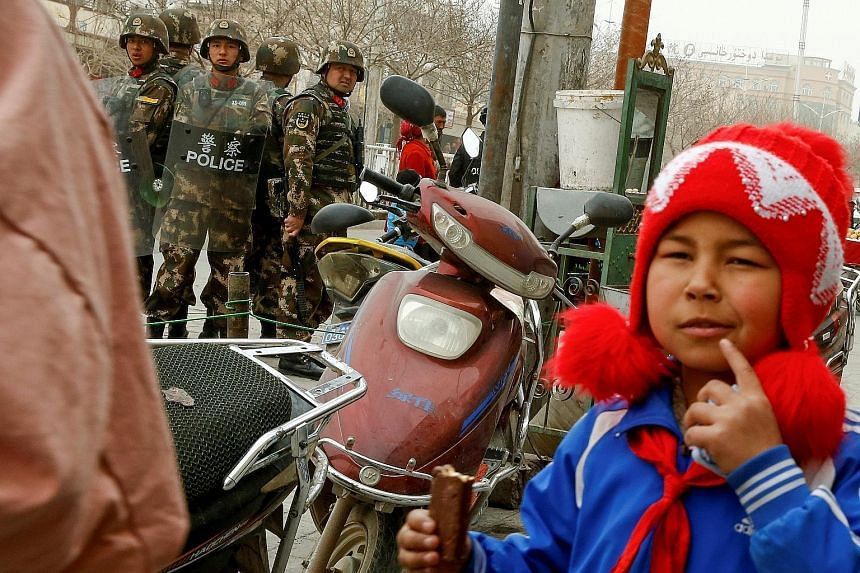 Above: Security personnel in Kashgar city, in the Xinjiang Uighur Autonomous Region of China. The writer says it is true that Chinese Muslims are subject to greater surveillance, but they also receive some preferential exemptions. For example, the on