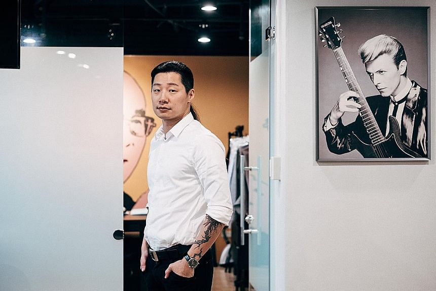 A poster of singer David Bowie hangs in the office of Freddy Lim (left), who has put his music career of more than two decades on hold to serve as a member in Taiwan's Legislative Yuan, or parliament.