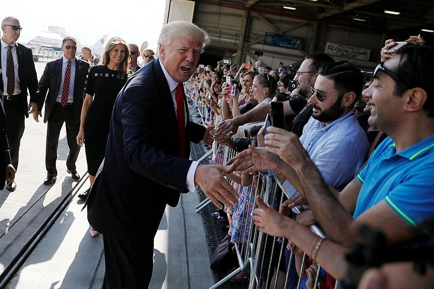 Mr Donald Trump greeting US service members at a rally in Sigonella Air Force Base at the end of his participation in the Group of Seven summit in Sicily, Italy, last Saturday.