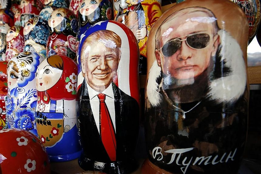 Nesting dolls painted with the images of Mr Donald Trump and Russian President Vladimir Putin in a gift shop in Moscow. The latest White House furore ignited after it was reported that Mr Jared Kushner proposed to the Russian ambassador to set up a s