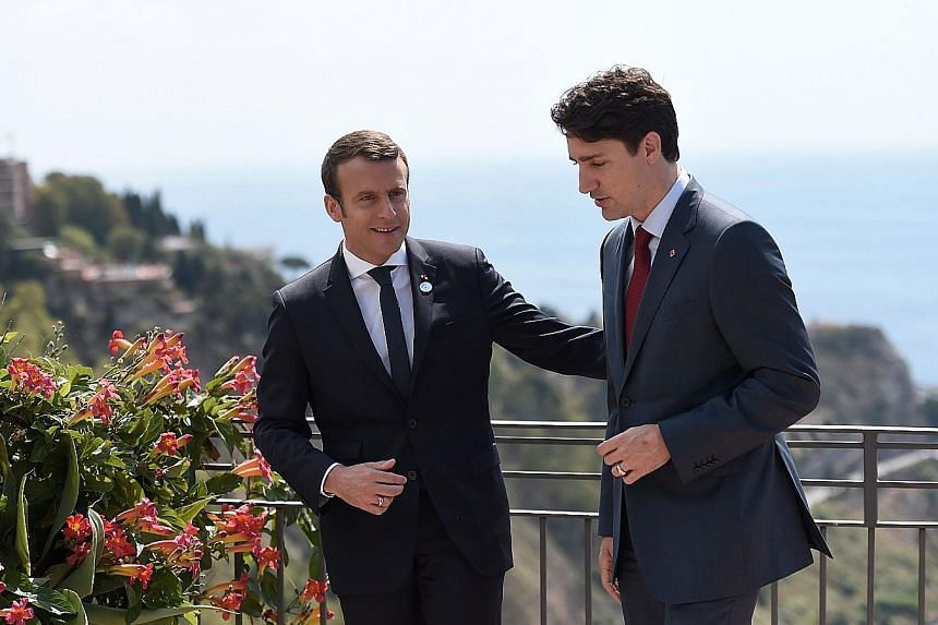 Mr Emmanuel Macron (left) held a bilateral meeting with Mr Justin Trudeau during the G-7 summit in Taormina last Friday.