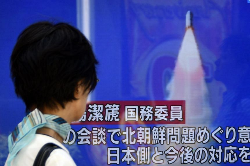A pedestrian watching a TV on a street broadcasting news of North Korea's missile launch in Tokyo, Japan, on May 29.
