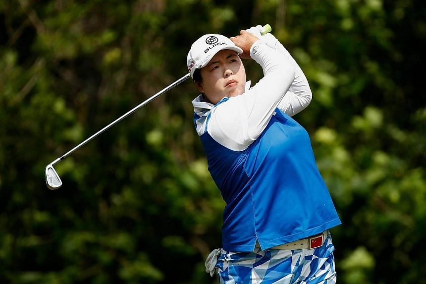 Shanshan Feng watches her tee shot on the seventh hole during the final round of the LPGA Volvik Championship.