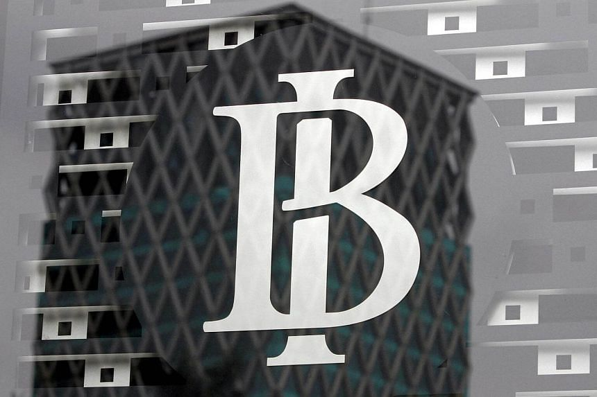 The logo of Indonesia's central bank, Bank Indonesia, is seen on a window in the bank's lobby in Jakarta.