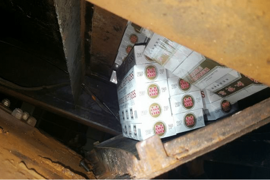 The contraband cigarettes were hidden in a modified compartment at the base of the tanker. PHOTO: IMMIGRATION AND CHECKPOINTS AUTHORITY