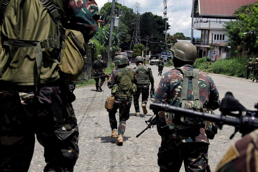 Government soldiers advance their positions in Marawi City, Philippines, on May 28, 2017.